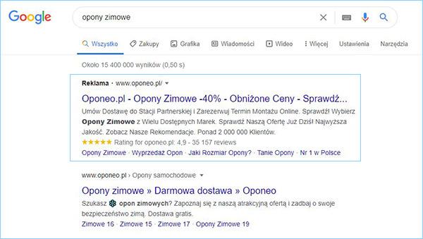 """Przykład reklamy tekstowej w wynikach wyszukiwania Google wyrażenia """"opony zimowe""""."""